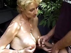Granny whore goes horny by the car